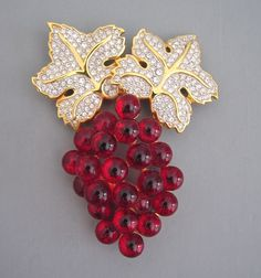 SWAROVSKI red glass grapes brooch, 1990s from Morning Glory Jewelry. Buy now for $198.00