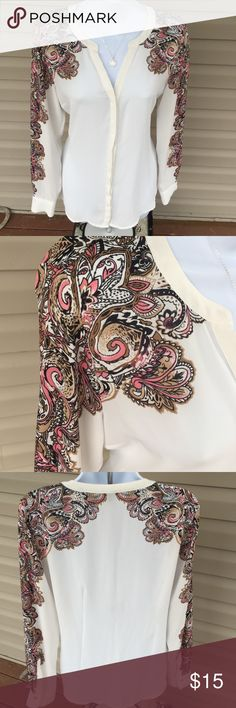 Ivory blouse w/print Ivory blouse w/ print on shoulder and sleeve. V-neck line. Peekaboo button down 100%Polyester. Size 6 Dana Buchman Tops Blouses