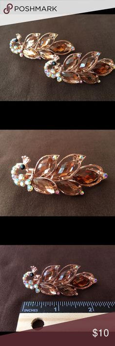 Rhinestone Peacock Hair Accessory NWOT - This is a pair of very pretty rhinestone peacock hair clips that look great when wearing. The sun reflects off of the rhinestones and makes them sparkle and shine. They are brand new without the tags 🌺 Bundle some of the other great Jewelry & Hair Accessories to take advantage of bundle discounts & to save big on shipping 💕 Accessories Hair Accessories