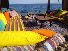 Dahab, Egypt. Its a place to flop, eat, walk, scuba, snorkel and the cheapest place on earth I have ever been.