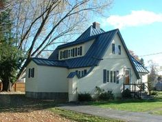 Blue Tin Metal Roof Pictured With Cedar Siding