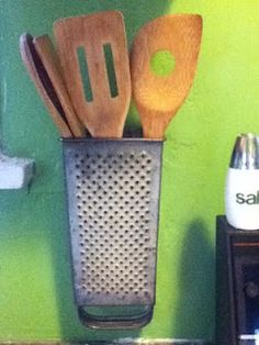 A vintage cheese grater makes a nice utensil holder especially wooden utensils.>>> I've always liked the way old graters look, but I won't use rusty, so I like this idea. And you can always find them at second hand stores.