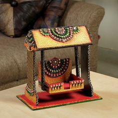 A sweet looking jhula that has been crafted with solid for Decoration items made at home