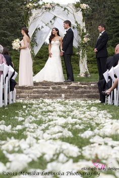 We ove all the added fabric and petals to this wedding we designed in 2013. Elizabeth Wray Design-Geneva,IL