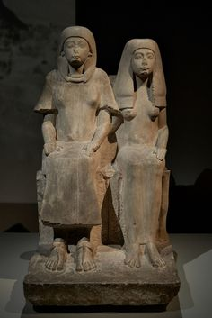 Rotterdam, Kunsthal, January 2012  From the collection of the Rijksmuseum van Oudheden, Leiden, as part of the exhibition Mummies!  This uninscribed statue of a seated couple has recently been identified as the general (and future pharaoh) Horemheb, and his first wife Amenia. Compare this statue in the British Museum.  AST 4. New Kingdom, 18th Dynasty (14th Century BCE). From Sakkara. Limestone.