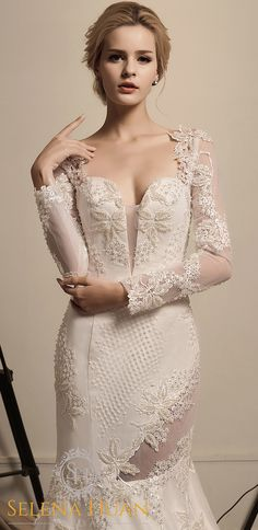 This beaded lace gown outlining the romantic grape vines all over the body with a whimsical illusion on legs blends soft, vintage romance with the modern soul of today's discerning bride. This wedding dress features long sleeves, plunging illusion neckline, and an elegant yet sexy back button detail. Its long sleeves twined with lace vines provide glamorous coverage of shoulders and arms. Its deep v-neckline accentuates the bustline, while sheer low back adds exemplifies elegance and…