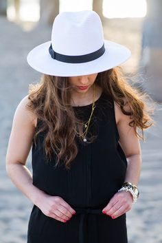 A beachy jumper, Panama hat, and simple gold jewelry