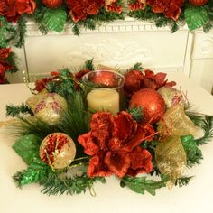 Red Magnolia Christmas Centerpiece with Globe CR1513 - Decorate you table with our beautiful red magnolia centerpiece. Created with glistening red magnolias, ribbon  and ornaments.