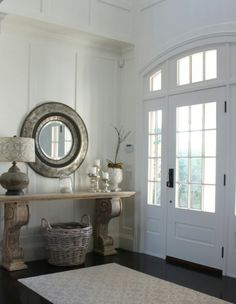 Entry with ornate mirror and side table