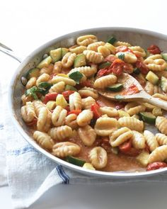 Gnocchi with Summer Vegetables - Made from potato, gnocchi are thicker and more pillowy than wheat pasta. When tossed with sauteed squash and grape tomatoes, they make a starchy contrast to the tender veggies.