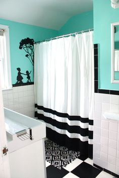 teal bathroom with grey, black and white