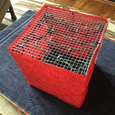wrapping fabric around chicken wire lighted gift boxes to use as outdoor christmas decorations