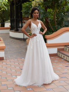 Special Order - Allow 4-6 months. This a-line gown features beaded lace and a deep v-neckline and is sampled in bridal sizes 8 (coming soon) and 14, in the color pictured and all ivory. Available to order in sizes 2-28, in ivory/taupe/rose, all ivory, or all white.