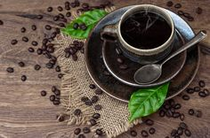 Black coffee with beans and leaves by LiliGraphie on Creative Market