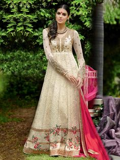 Cream georgette heavily embroidered anarkali suit is available for purchase at http://sairasboutique.net