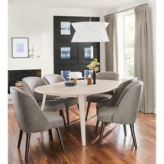 Lowell Round Extension Table - Lowell Extension Table with Cora Chairs - Modern Dining Room Furniture - Room & Board