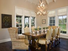 Jenniferfrancis: Light filled Dining Room with wing captain chairs and antler chandelier