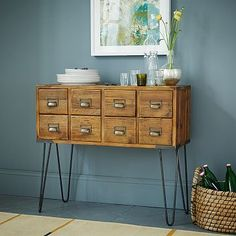The warmth of the wood and the almost too delicate look of the hairpin legs fits in beautifully with country, mid century modern or eclectic.  It would be a fun addition to any room!
