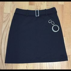 NY&C Black Skirt w/ Silver Buckle New York & Company Black Skirt w/ Silver Buckle. Size: small. Such a great staple in any work wardrobe. Great condition! Jewelry not included. New York & Company Skirts