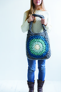 Carry everything you need in this perfectly-sized bag. It's based on a giant circular-centred granny square motif and crocheted by holding two strands of yarn together. #crochetpatterns