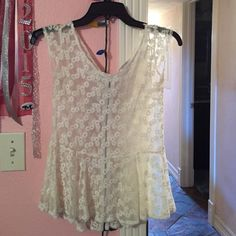 White see threw shirt. It is tighter around the chest and has a little flor off the bottom. Can be dressed up or dressed down. American Eagle Outfitters Tops Blouses