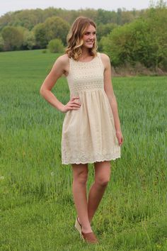 This Crotchet Detailed Top Sleeveless Dress is beautiful. The Bottom off the Dress a Natural Color and has off white stripes and  eyelet detail.$49.99 at tyalexanders.com