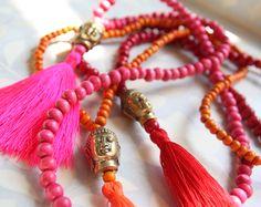 Halskette mit Messing Buddha, Farbig   39 €