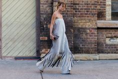 A Strapless Dress Over Wide-Leg Trousers Is a Winning Combination With a Casual Touch