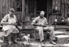 Sally and Clarence Fleming carving near the porch of their house in Brasstown, NC around 1935. The Flemings were known for their whimsical carved animals. They sold their carvings through the woodcarving cooperative at John C. Campbell Folk School, which became known as the Brasstown Carvers.