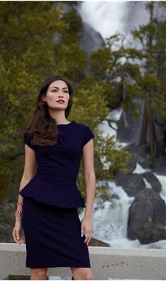 Blue, steep and dangerous, this dress perfectly mimics the famous climbers' cliff after which it is named.  The woven cotton poplin/spandex blend fabric combines with a fitted skirt and bodice to create a sensuous silhouette.  An eight inch ruffle at the waistline adds the perfect feminine flare