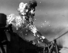 A successful kamikaze mission is seen here: The flaming remains of a shot-up Japanese plane manages to hit the carrier Intrepid.