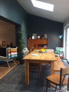 Extension dining area. Inchyra blue walls, slate floor. Teak sideboard love... junk shop bargain. Ekenaset Ikea chair. Made.com lamp. Cox and Cox table.