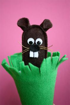 Hiding Ground Hog Puppet - could also do as finger puppet.  Take him out and see if you can find his shadow- this link also has creepy rad meatloaf in shape of groundhog