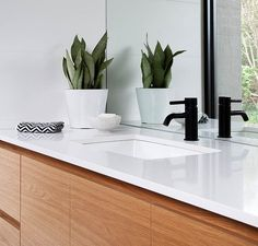 A palette of black, white and wood, feature in this bathroom