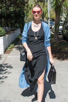 Going with the flow: For her day of shopping, the 26-year-old stepped out in a black maxi ...