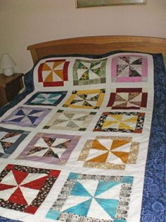 Modern colourful scrappy pinwheel single bed quilt by StephsQuilts, $220.00