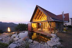 Ferienhaus Österreich | Stadl am Tunauberg, das Premium-Ferienhaus von PURESLeben für zwei mit Sauna, Naturbiotop & Serviceleistungen Nähe Graz, Österreich.