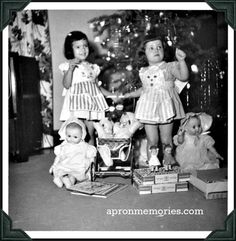 """Vintage Holiday: Post by Jennifer Utter @apronmemories says """"This picture was taken on Christmas day, 1954. My sister's kitty face apron is pink and white stripes, and my puppy face apron is blue and white stripes."""""""
