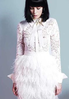 Feather skirt and lace shirt