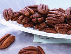 Sweet and Spicy Pecans 1 Tbs. butter or peanut oil 2 Tbs. dark corn syrup ½ tsp. salt ½ tsp. cinnamon ¼ tsp. cayenne 2 ½ cups pecan halves Preheat oven to 250F.
