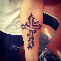 Amazing Cross Tattoo Design on Arm for Men | Cool Tattoo Designs