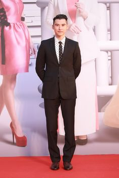 Hong Kong actor Carlos Chan wearing Burberry tailoring to attend the 35th Hong Kong film awards