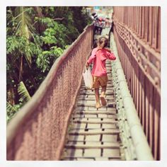 Running pink kid on the bridge - Luang Prabang