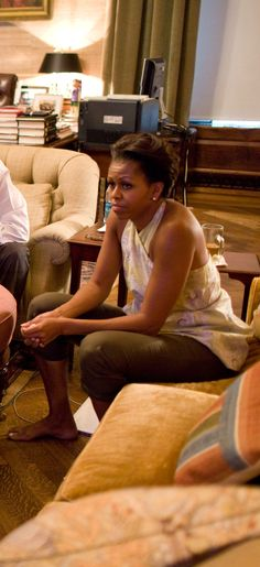 Michelle Obama - I love this pic. This woman doesn't even know how to not just BE herself, no pretense - gorgeous.