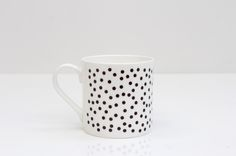 Monochrome 'Dotty' design Bone China mug. Each mug has it's design individually transferred onto it by hand in Rolfe&Wills's Bristol.    Contemporary Design