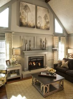 Stunning living room: Vaulted, cathedral ceiling; unique antiqued coffee table; textured rug; greys, yellow-beiges, whites, silver  Residential - Kandrac-Kole