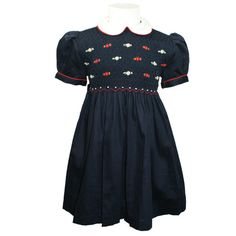 """Victoria (Navy) - Traditional smocked dress with embroidery overlay.  Styled with short """"cuff"""" sleeves and """"Peter Pan"""" collar. Button fastening at the back, with matching fabric """"ribbons"""" to tie a bow.  Fabric piping to collar and cuffs to compliment embroidery. Available in sizes 6 months - 8 years."""