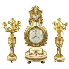 For Sale on - A very fine quality French century clock and garniture suite. Comprising an ormolu-mounted white marble mantel clock and a pair of gilt bronze and Antique Desk, Antique Clocks, Mantel Clocks, Mantle, French Clock, Marble Columns, Decorative Mouldings, White Enamel, Decorative Objects