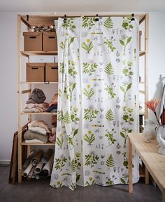 Storage baskets and boxes are dorm room necessities and can be decor too. Hook fabric onto your shelves to make a statement while hiding your stuff. This white, watercolor floral-patterned DORTHY fabric from IKEA creates a cute, nature-lover look.