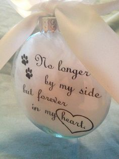 This beautiful glass memorial ornament is a wonderful way to remember a beloved pet who has passed. The ornament is 3x3.5 inches in dimension and just over 1 inch thick. The inside is filled with soft white feathers and the words No longer by my side but forever in my heart. printed on white vellum, also inside the ornament. **This is also available with the words ...Our Sides... Our Hearts... please click here…